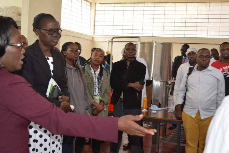 Dr. J. Ambuko explains as staff and students listens