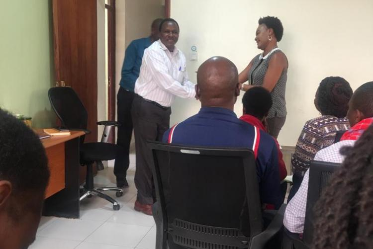 Dr. Kunyanga Issuing Certificates after training